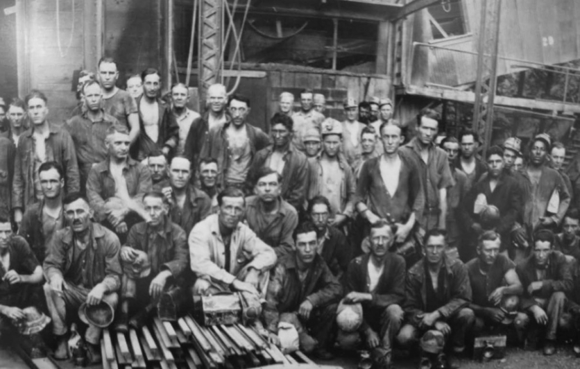 Historical photo of miners with lunch pails