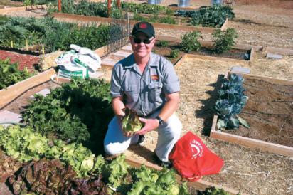 Community garden, Agritopia, Man planting