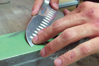 close up of knife, sharpening