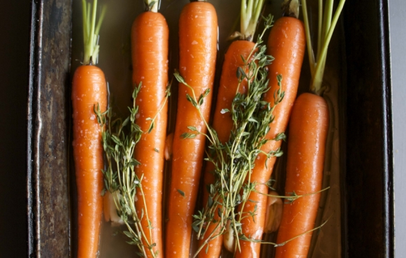 Carrots in pan with herbs ready for braising