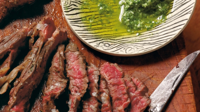 Carved flank steak with carrot top pesto