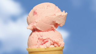 Two scoops of ice cream on a cone